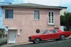 Pink_house_red_car